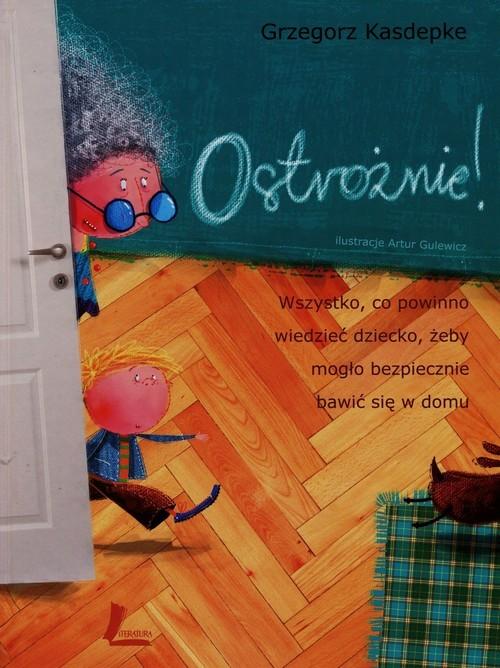 okładka Ostrożnie Wszystko, co powinno wiedzieć dziecko, żeby mogło bezpiecznie bawić się w domuksiążka      Grzegorz Kasdepke